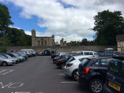 The Abbey ruins behind the car part in Glastonbury