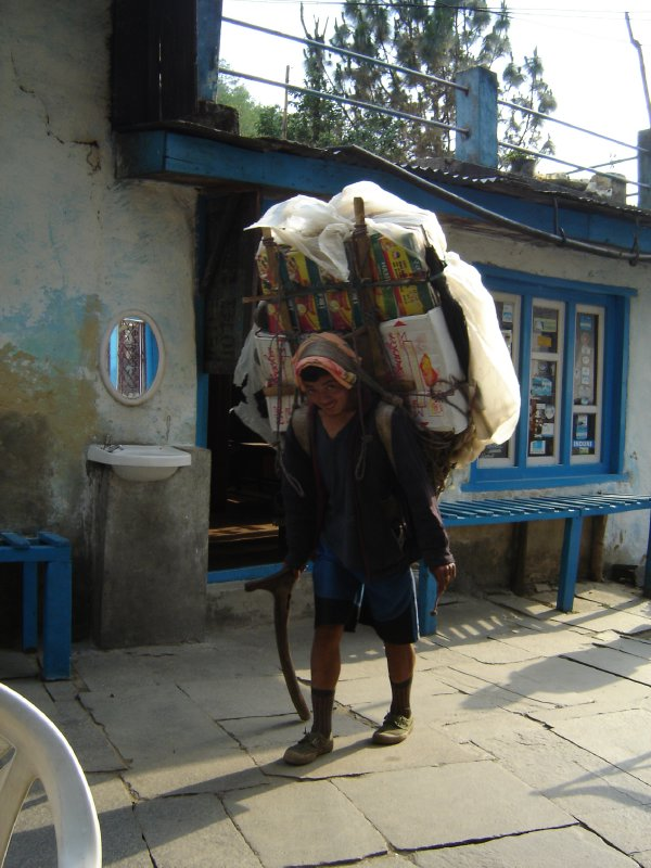 Above: A porter carrying his supplies through Kinja.