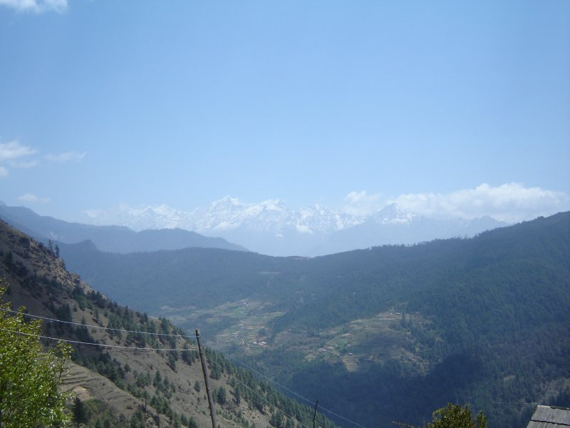 Above: The village of Ringmu can be seen on the other side of the valley with the Taksindu Pass (3070m) above.