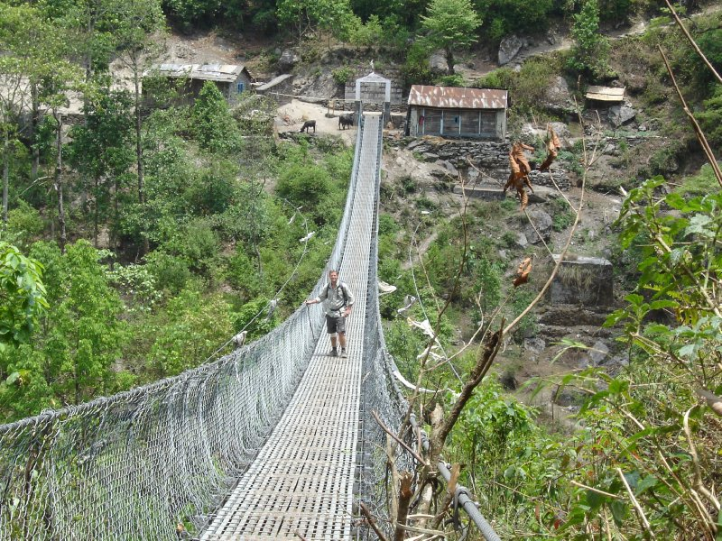 Above: Phil holding on firmly to the suspension bridge which crosses the Dudh Khosi river.