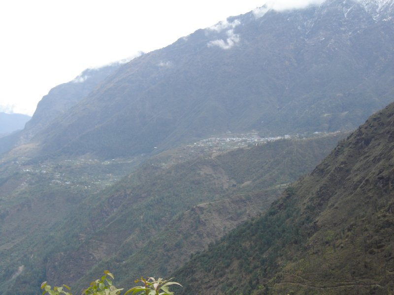 Above: Lukla on the right of centre. The airstrip runs steeply downhill before the land disappears and the planes hurtle into a narrow valley. You can see a plane coming in to land if you look closely.