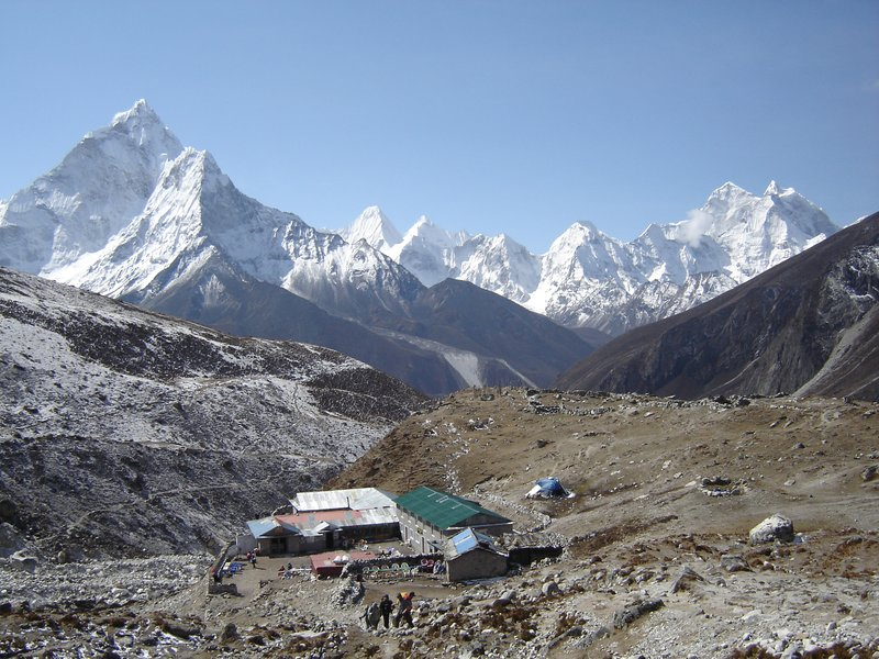 "Above: Looking back to the ""village"" of Dughla on the climb up to Lobuche Pass with Ama Dablam and the Hinku Himal range in the background."