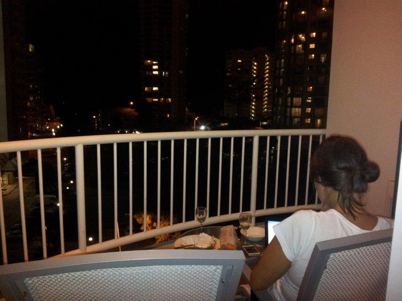 large_drinking_wine_on_balcony.jpg