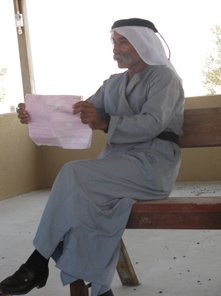 Sheikh Sayed showing us the demolition order for the entire village of Al Arakib