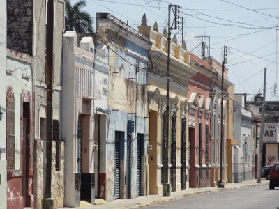 run down beside renovated homes in Merida