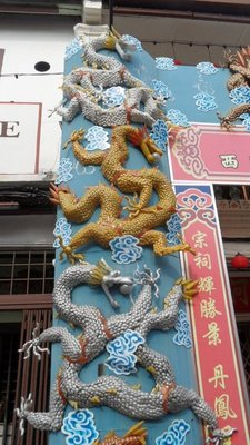Chinatown dragon made of recycled plastic spoons and coke bottles