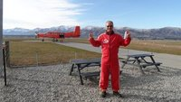 The Fool and the plane he is about to jump out of at 12000 ft