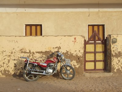 Motorbike in Oasis town of Al Qasr