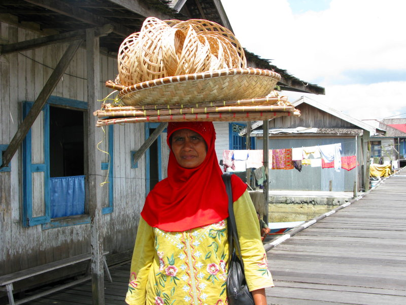 Local woman bringing her handicraft to market