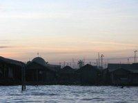 Sunrise over canal in Banjamasin