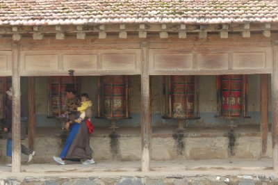 Tibetan women spinning prayer wheels
