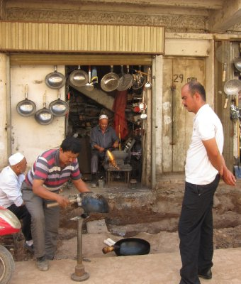 Craftmen at work. Getting your wok fixed. Kashgar