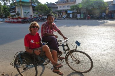 Rickshaw travel. The poor guy pedalling would have the weight of me too, facing backwards behind Dan