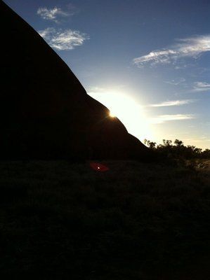 The sun's corona beside Uluru