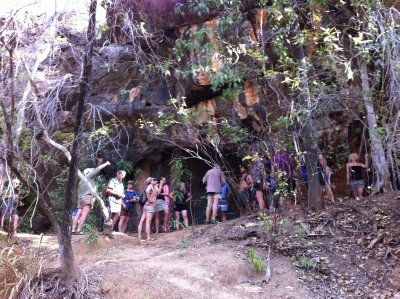 Looking at rock art at the other end of Tunnel Creek