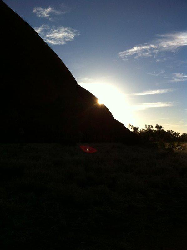 The sun's corona beside Uluru