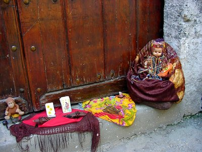Babalao (santeria)doll at the church door