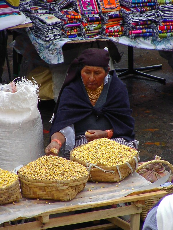 women selling corn