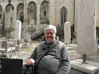 Hugh in a cafe near the Palais des Papes