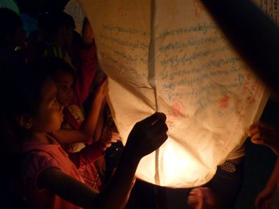 Luanching a chinese lantern covered in the kids wishes