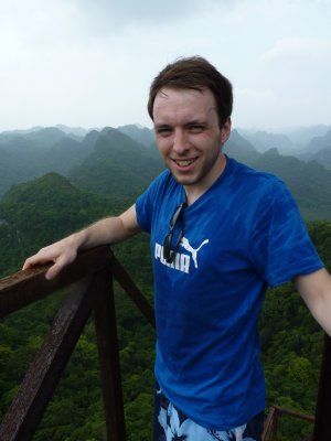 Graeme at the top of a tall tower at thr top of a tall mountain on Cat Ba island