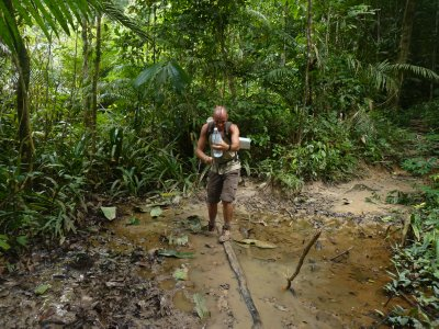 Me crossing a muddy jungle swamp