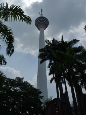 KL Tower from below - flanked by tropical trees