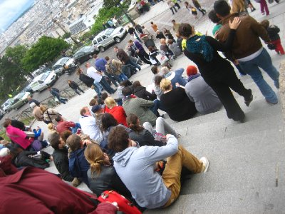 sitting on the steps of sacre coeur
