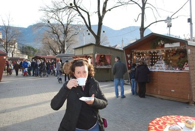 Lisa reviving in front of the Christmas market stalls