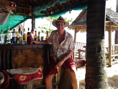 Mick at bar at Farmai, beach restaurant