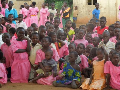 Children patiently waiting in pink school uniforms