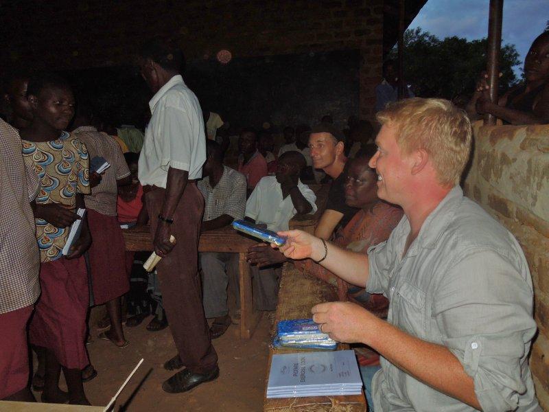 Rainer handing out school supplies