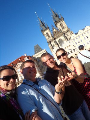 The Grimms, guests, and piggies saying Happy Father's Day from Prague