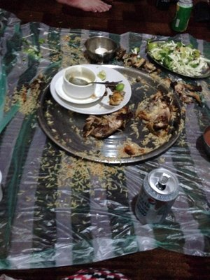 they also tried traditional Omani food where you sit on the floor and eat from a giant platter with your hands