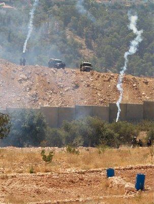 Israelis shooting tear gas across the wall