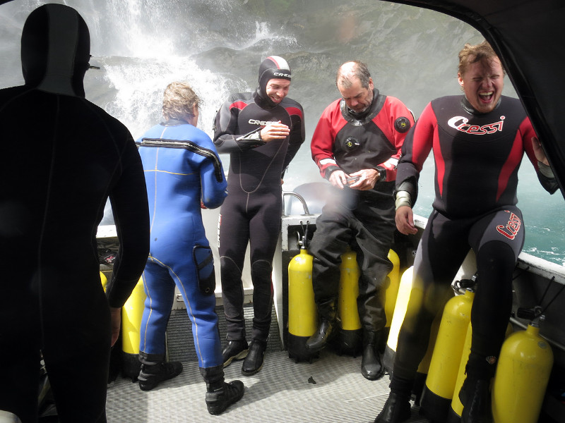 Back on the boat, the captain gets really close to the waterfall. © Descend Scubadiving