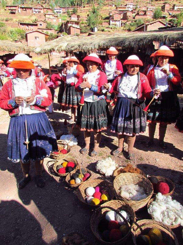 Women spinning thread