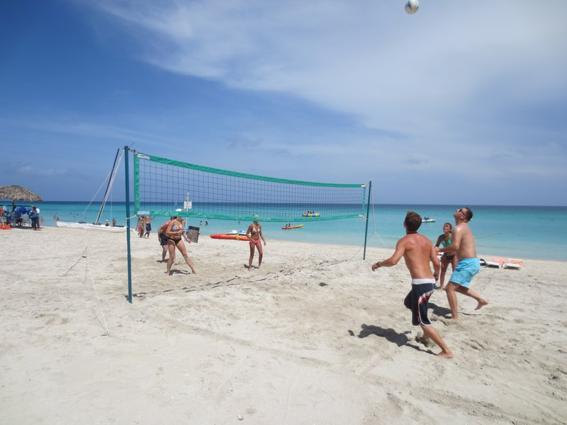 Christian playing volleyball