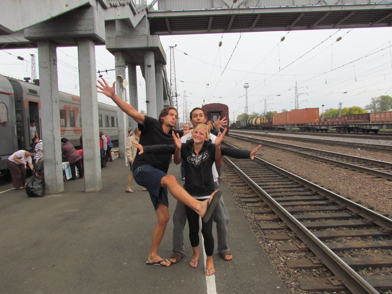 Roel, Steve and Renee keeping themselves entertained at a train stop