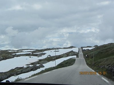 Straight stretch of road through snow fields