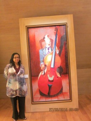 Mala standing near a painting in the Nevers Museum