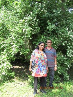 Mala and Andrew near a Russian Jasmine bush