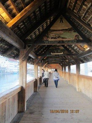 Mala and Helen walking on the old bridge in Luzerne