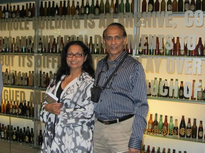 Andrew and Mala at Guiness Store with old bottles