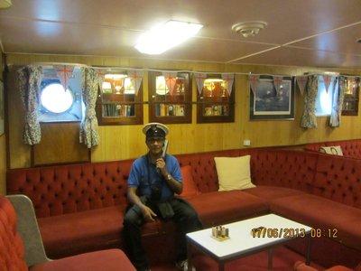 Andrew, posing as Captain of the ship, Britannia