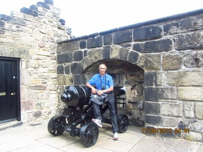 Andrew sitting on a cannon at Edinburgh Castle