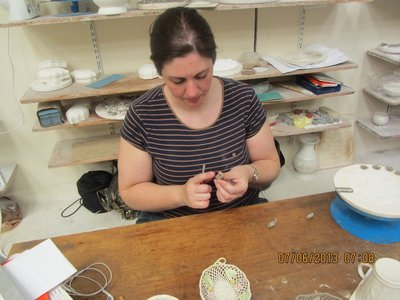 Belleek craftsperson making hand made ceramic flowers