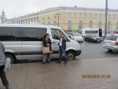 Driver explaining sonmething to Mala