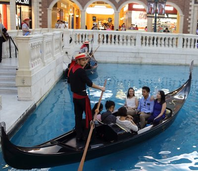 Gondola rides on the clear water way.