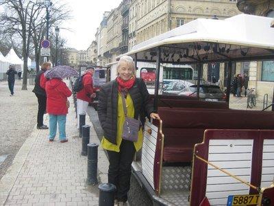 Helen near the sight seeing open vehicle in Boedeaux